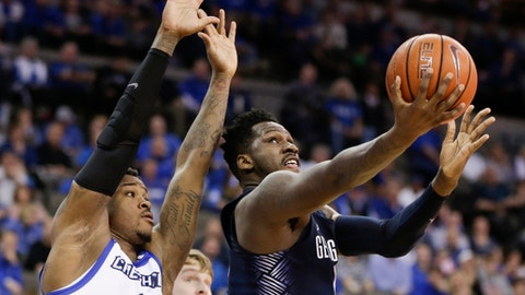 Georgetown's L.J. Peak, right, goes for a layup against Creighton's Marcus Foster (0) during the first half of an NCAA college basketball game in Omaha, Neb., Sunday, Feb. 19, 2017. (AP Photo/Nati Harnik)