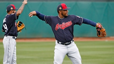 Cleveland Indians' Edwin Encarnacion, right, and Ronny Rodriguez, left, warm up at the team's baseball spring training facility Sunday, Feb. 19, 2017, in Goodyear, Ariz. (AP Photo/Ross D. Franklin)