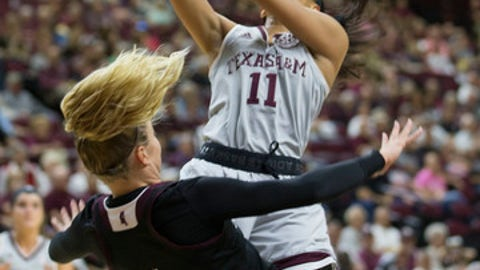 Texas A&M guard Curtyce Knox (11) is fouled by Mississippi State guard Blair Schaefer (1) while shooting during the first half NCAA college basketball game, Sunday, Feb. 19, 2017, in College Station, Texas. (AP Photo/Sam Craft)