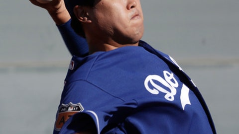 FILE - In this Feb. 14, 2017, file photo, Los Angeles Dodgers' Hyun-Jin Ryu throws during a spring training baseball workout in Glendale, Ariz. Ryu believes he is ready to reclaim his long-lost spot in the Dodgers' starting rotation. (AP Photo/Morry Gash, File)
