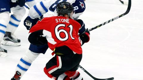 Ottawa Senators' Mark Stone (61) is hit by Winnipeg Jets' Jacob Trouba (8) during third period NHL hockey action in Ottawa, Sunday Feb. 19, 2017. (Fred Chartrand/The Canadian Press via AP)