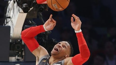 Western Conference guard Russell Westbrook of the Oklahoma City Thunder (0) makes a dunk during the first half of the NBA All-Star basketball game in New Orleans, Sunday, Feb. 19, 2017. (AP Photo/Gerald Herbert)