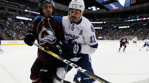 Tampa Bay Lightning center Brian Boyle, right, checks Colorado Avalanche defenseman Mark Barberio in the second period of an NHL hockey game Sunday, Feb. 19, 2017, in Denver. (AP Photo/David Zalubowski)