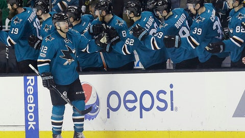 San Jose Sharks center Patrick Marleau (12) is congratulated by teammates after scoring a goal during the second period of an NHL hockey game against the Boston Bruins in San Jose, Calif., Sunday, Feb. 19, 2017. (AP Photo/Jeff Chiu)