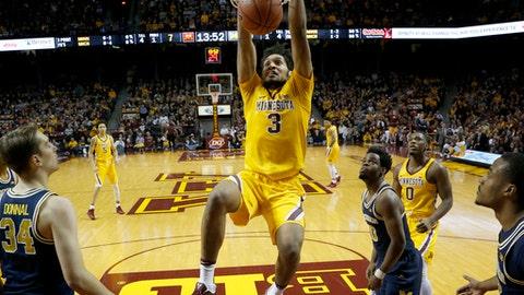 Minnesota's Jordan Murphy (3) dunks during an NCAA college basketball game against Michigan, Sunday, Feb. 19, 2017, Minneapolis. (Carlos Gonzalez/Star Tribune via AP)