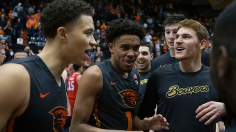 Oregon State's Stephen Thompson Jr., center, celebrates with his teammates after the Beavers defeated Utah 68-67 in an NCAA college basketball game in Corvallis, Ore., Sunday, Feb. 19, 2017. Thompson Jr. scored 31 points in leading the Beavers to their first win in a Pac-12 Conference game this year. (AP Photo/Timothy J. Gonzalez)