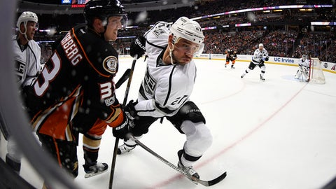 Anaheim Ducks right wing Jakob Silfverberg, left, of Sweden, and Los Angeles Kings defenseman Alec Martinez battle during the second period of an NHL hockey game, Sunday, Feb. 19, 2017, in Anaheim, Calif. (AP Photo/Mark J. Terrill)