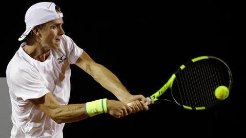 Belgium's Arthur De Greef returns the ball to Pablo Cuevas of Uruguay, at the Rio Open tennis tournament in Rio de Janeiro, Brazil, Monday, Feb. 20, 2017. (AP Photo/Felipe Dana)