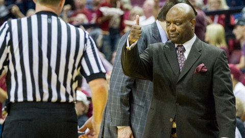 Florida State head coach Leonard Hamilton gives a referee a thumbs-up after being moved back to his coaching area in the first half of an NCAA college basketball game against Boston College in Tallahassee, Fla., Monday, Feb. 20, 2017. (AP Photo/Mark Wallheiser)