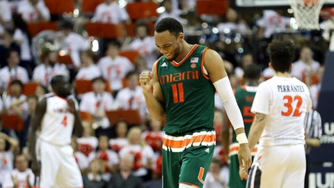 Miami guard Bruce Brown (11) celebrates during overtime of an NCAA college basketball game against Virginia, Monday, Feb. 20, 2017, in Charlottesville, Va. Miami defeated Virginia 54-48. (AP Photo/Ryan M. Kelly)