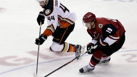 Arizona Coyotes right wing Shane Doan (19) back checks Anaheim Ducks center Nate Thompson in the third period during an NHL hockey game, Monday, Feb. 20, 2017, in Glendale, Ariz. Arizona defeated Anaheim 3-2. (AP Photo/Rick Scuteri)