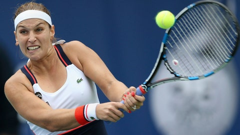 Dominika Cibulkova of Slovakia returns the ball to Ekaterina Makarova of Russia during the Dubai Tennis Championships in Dubai, United Arab Emirates, Tuesday, Feb. 21, 2017. (AP Photo/Kamran Jebreili)