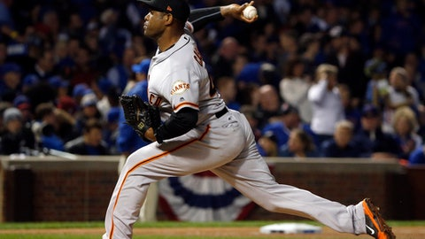 """FILE - In this Oct. 8, 2016 file photo, San Francisco Giants relief pitcher Santiago Casilla (46) throws in the sixth inning of Game 2 of baseball's National League Division Series against the Chicago Cubs in Chicago.   Casilla awaits his paperwork to depart the Dominican Republic and rejoin the Oakland Athletics, he has been speaking with young baseball players at the team's academy in his home country.  A's manager Bob Melvin is hopeful that could be """"any day"""" for the right-handed reliever, who has been delayed by visa issues, a common occurrence in the Dominican Republic for baseball players and something he regularly dealt with during his first stint with Oakland. (AP Photo/Nam Y. Huh)"""