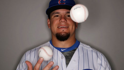 Chicago Cubs' Kyle Schwarber juggles during the team's photo day Tuesday, Feb. 21, 2017, in Mesa, Ariz. (AP Photo/Morry Gash)