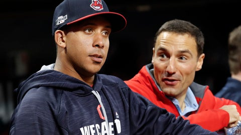 FILE - This Oct. 5, 2016 file photo shows Cleveland Indians' Michael Brantley, left, talking with team president Chris Antonetti during baseball practice in Cleveland. Brantley is convinced the 'bad days' are behind him after he missed nearly all of 2016 following shoulder surgery. The former All-Star played in just 11 games and watched as his teammates made the World Series. Brantley hasn't been cleared to hit during spring training but remains positive about his recovery. (AP Photo/David Dermer, file)