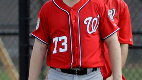 FILE - In this Feb. 19, 2017, file photo, Washington Nationals first baseman Adam Lind (73) watches a spring training baseball workout in West Palm Beach, Fla. Even if he was signing with an annual contender that has a first baseman coming off his worst season in the majors and an aging left fielder, Lind spoke in frank terms while discussing what his contract offer from the Nationals meant. (AP Photo/David J. Phillip, File)