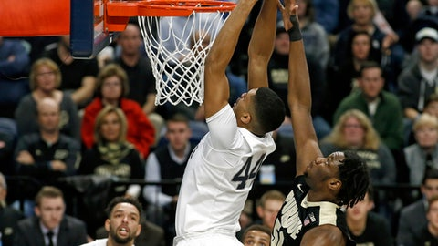 Penn State's Julian Moore (44) goes up for the dunk as Purdue's Caleb Swanigan (50) defends during the first half of an NCAA college basketball game in State College, Pa., Tuesday, Feb. 21, 2017. (AP Photo/Chris Knight)