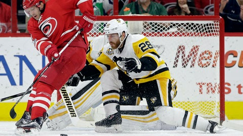 Pittsburgh Penguins' Ian Cole (28) defends against Carolina Hurricanes' Lee Stempniak (21) during the first period of an NHL hockey game in Raleigh, N.C., Tuesday, Feb. 21, 2017. (AP Photo/Gerry Broome)