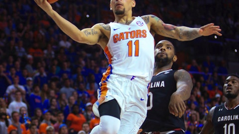 Florida guard Chris Chiozza (11) shoots in front of South Carolina guard Sindarius Thornwell (0) during the first half of an NCAA college basketball game Tuesday, Feb. 21, 2017, in Gainesville, Fla. (AP Photo/Matt Stamey)