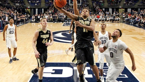 Purdue's P.J. Thompson (11) drives to the basket against Penn State during the second half of an NCAA college basketball game in State College, Pa., Tuesday, Feb. 21, 2017. Purdue won 74-70 in overtime. (AP Photo/Chris Knight)