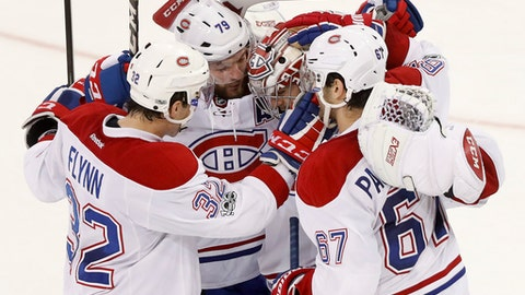 Montreal Canadiens celebrate after the Canadiens defeated the New York Rangers 3-2 in a shootout in an NHL hockey game, Tuesday, Feb. 21, 2017, in New York. (AP Photo/Julie Jacobson)