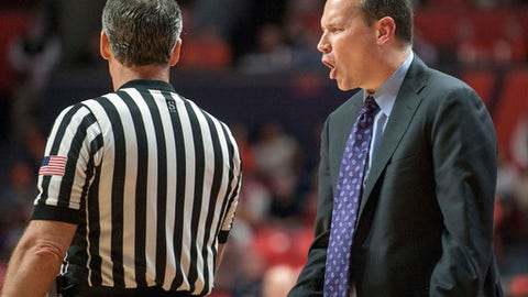 Northwestern coach Chris Collins shouts at an official during the first half of the team's NCAA college basketball game against Illinois in Champaign, Ill., Tuesday, Feb. 21, 2017. (AP Photo/Rick Danzl)