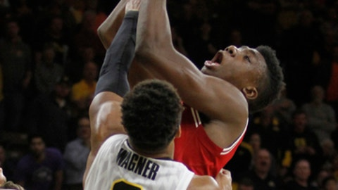 Indiana's Thomas Bryant (31) shoots in front of Iowa's Ahmad Wagner (0) during the first half of an NCAA college basketball game, Tuesday, Feb. 21, 2017, in Iowa City, Iowa. (AP Photo/Matthew Holst)