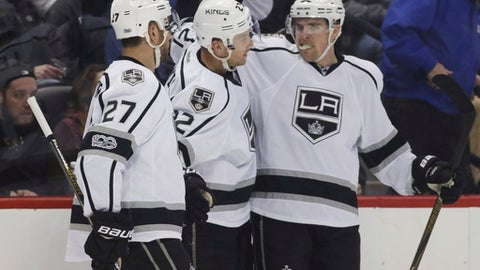 Los Angeles Kings center Trevor Lewis, center, is congratulated after scoring a goal by defenseman Alec Martinez, left, and left wing Tanner Pearson against the Colorado Avalanche in the second period of an NHL hockey game, Tuesday, Feb. 21, 2017, in Denver. (AP Photo/David Zalubowski)