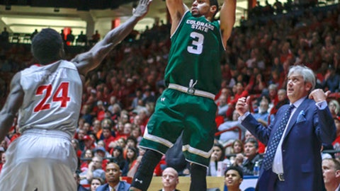 Colorado State's Gian Clavell (3) shoots a 3-pointer over New Mexico's Damien Jefferson (24) during the first half of an NCAA college basketball game in Albuquerque, N.M., Tuesday, Feb. 21, 2017. (AP Photo/Juan Antonio Labreche)