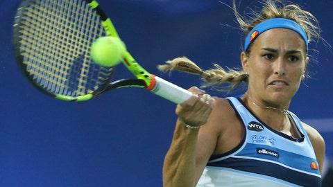 Monica Puig of Puerto Rico returns the ball to Angelique Kerber of Germany during the Dubai Tennis Championships, in Dubai, United Arab Emirates, Wednesday, Feb. 22, 2017. (AP Photo/Kamran Jebreili)