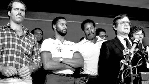"""FILE - In this Nov. 16, 1982 file photo, with players behind him, the NFL's chief negotiator Ed Garvey tells reporters that """"there is not a deal that is even close,"""" in New York. From left are Dave Stalls, Tampa Bay; Burgess Owens, Los Angeles Raiders; James Lofton, Green Bay Packers; Gene Upshaw, L.A. Raiders, Garvey and Stan White, Detroit Lions. Garvey, the lawyer who led the National Football League Players Association through strikes in 1974 and 1982, has died at age 76. Garvey was the players' union counsel and executive director from 1971-83.  (AP Photo/Ray Stubblebine, File)"""
