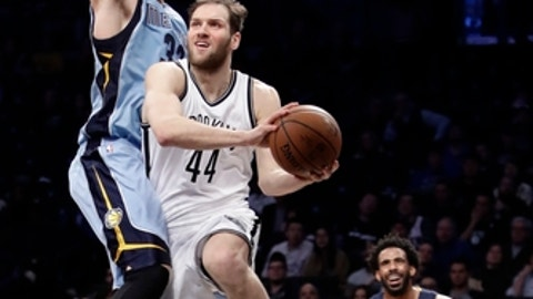 Brooklyn Nets' Bojan Bogdanovic (44) is defended by Memphis Grizzlies' Marc Gasol (33), of Spain, as Mike Conley (11) watches during the second half of an NBA basketball game Monday, Feb. 13, 2017, in New York. The Grizzlies won 112-103. (AP Photo/Frank Franklin II)