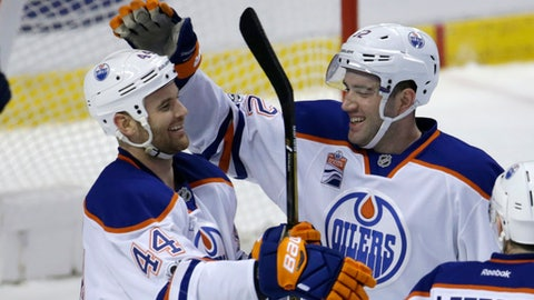 Edmonton Oilers defenseman Eric Gryba (62) celebrates with right wing Zack Kassian (44) after scoring a goal against the Florida Panthers during the second period of an NHL hockey game, Wednesday, Feb. 22, 2017, in Sunrise, Fla. (AP Photo/Lynne Sladky)