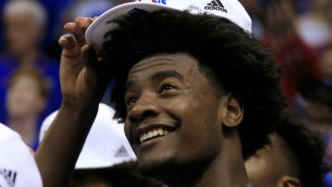 Kansas guard Josh Jackson dons his Big 12 championship hat following the team's NCAA college basketball game against TCU in Lawrence, Kan., Wednesday, Feb. 22, 2017. Kansas defeated TCU 87-68. The Jayhawks clinched at least a tie for their 13th straight Big 12 title. (AP Photo/Orlin Wagner)