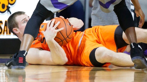 Oklahoma State guard Phil Forte III (13) looks for an out after falling to the floor under the basket during an NCAA college basketball game against Kansas State, Wednesday, Feb. 22, 2017, in Manhattan, Kan. (Bo Rader/The Wichita Eagle via AP)