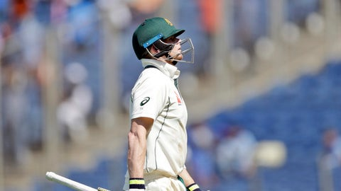 Australia's captain Steve Smith walks back to the pavilion after being dismissed during the first day of the first test cricket match against India in Pune, India, Thursday, Feb. 23, 2017. (AP Photo/Rajanish Kakade)