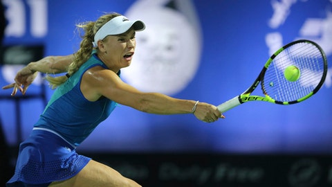 Caroline Wozniacki of Denmark returns the ball to Catherine Bellis of the U.S. during a quarter final match of the Dubai Tennis Championships in Dubai, United Arab Emirates, Thursday, Feb. 23, 2017. (AP Photo/Kamran Jebreili)