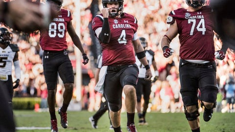 "File-This Nov. 5, 2016, file photo shows South Carolina quarterback Jake Bentley celebrating a touchdown during the first half of an NCAA college football game against Missouri in Columbia, S.C. Bentley's plans for South Carolina are much bigger than rallying the Gamecocks to a bowl. ""I'm thinking to stay here for four years right now,"" said Bentley, speaking publicly this week for the first time since taking over as the Gamecocks' starting quarterback last October as a freshman. ""I want to win a national championship, and however long that takes I'm going to do it,"" Bentley continued. ""The young talent that we have is definitely  ready to win a national championship, win an SEC championship.""(AP Photo/Sean Rayford, File)"