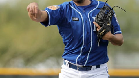 This photo taken Feb. 14, 2017, shows Kansas City Royals pitcher Joakim Soria throwing during spring training baseball practice, in Surprise, Ariz. Soria shouldn't have any issue with confidence, not with 202 career saves. Yet when he returned to Kansas City last season, armed with a $25 million, three-year deal to serve as the primary setup man for closer Wade Davis, his confidence appeared to be precisely the problem.(AP Photo/Charlie Riedel)