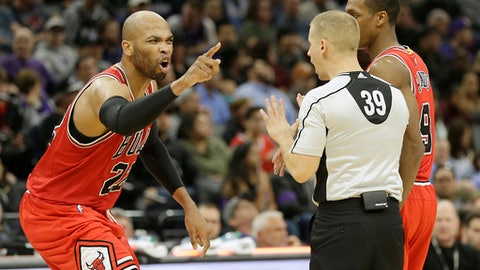 Chicago Bulls forward Taj Gibson, left, yells at referee Tyler Ford after he was called for technical foul during the second half of an NBA basketball game against the Sacramento Kings, Monday, Feb. 6, 2017, in Sacramento, Calif. The Bulls won 112-107. (AP Photo/Rich Pedroncelli)