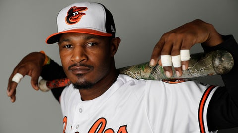 "FILE - In this Monday, Feb. 20, 2017 file photo, Baltimore Orioles' Adam Jones poses during the team's photo day at spring training baseball in Sarasota, Fla. Baltimore Orioles center fielder Adam Jones has been to the postseason three times in the past five years. That's not enough anymore for for the five-time All-Star and a four-time Gold Glove winner. Jones is ready for the Orioles to take the next steps ""to get out of that first round and past that wild card."" (AP Photo/David Goldman, File)"