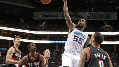Charlotte Hornets' Roy Hibbert (55) dunks over Portland Trail Blazers' Shabazz Napier (6) and Noah Vonleh (21) during the second half of an NBA basketball game in Charlotte, N.C., Wednesday, Jan. 18, 2017. The Hornets won 107-85. (AP Photo/Chuck Burton)