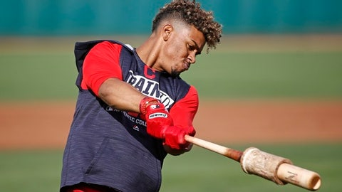 FILE - In this Tuesday, Feb. 17, 2017, file photo, Cleveland Indians shortstop Francisco Lindor takes a practice swing during batting practice at the team's baseball spring training facility in Goodyear, Ariz. Lindor, at 23, has blossomed into one of the game's rising young stars. (AP Photo/Ross D. Franklin, File)
