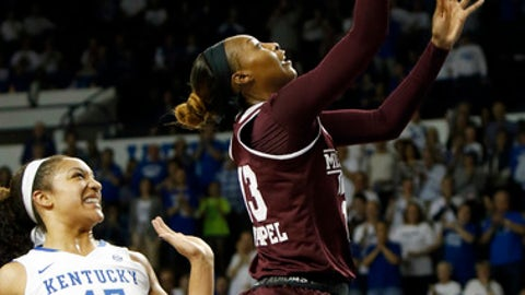 Mississippi State's Ketara Chapel, right, shoots near Kentucky's Alyssa Rice (45) during the first quarter of an NCAA college basketball game, Thursday, Feb. 23, 2017, in Lexington, Ky. (AP Photo/James Crisp)