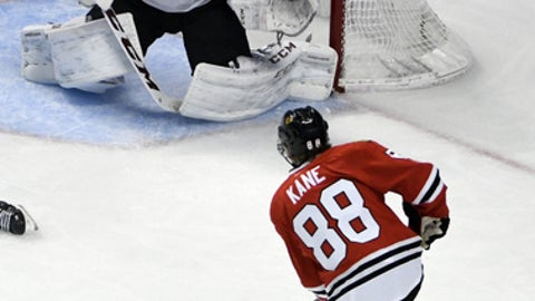 Chicago Blackhawks right wing Patrick Kane (88) scores a goal on Arizona Coyotes goalie Mike Smith (41) during the second period of an NHL hockey game Thursday, Feb. 23, 2017, in Chicago. (AP Photo/David Banks)