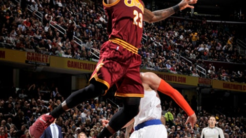 CLEVELAND, OH - FEBRUARY 23:  LeBron James #23 of the Cleveland Cavaliers goes to the basket against the New York Knicks on February 23, 2017 at Quicken Loans Arena in Cleveland, Ohio. NOTE TO USER: User expressly acknowledges and agrees that, by downloading and/or using this Photograph, user is consenting to the terms and conditions of the Getty Images License Agreement. Mandatory Copyright Notice: Copyright 2017 NBAE (Photo by David Liam Kyle/NBAE via Getty Images)
