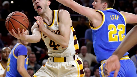 Arizona State guard Torian Graham (4) shoots under UCLA forward TJ Leaf (22) during the second half of an NCAA college basketball game, Thursday, Feb. 23, 2017, in Tempe, Ariz. (AP Photo/Matt York)