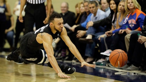 Gonzaga forward Johnathan Williams can't reach a loose ball before it went out of bounds during the first half of the team's NCAA college basketball game against San Diego on Thursday, Feb. 23, 2017, in San Diego. (AP Photo/Gregory Bull)