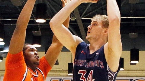 Saint Mary's center Jock Landale (34) shoots as Pepperdine forward Nolan Taylor (31) defends in the first half of an NCAA college basketball game in Malibu, Calif., Thursday, Feb. 23, 2017. (AP Photo/Reed Saxon)