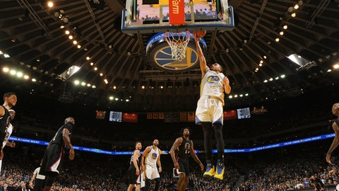 OAKLAND, CA - FEBRUARY 23: Stephen Curry #30 of the Golden State Warriors goes up for a lay up against the LA Clippers on February 23, 2017 at ORACLE Arena in Oakland, California. NOTE TO USER: User expressly acknowledges and agrees that, by downloading and or using this photograph, user is consenting to the terms and conditions of Getty Images License Agreement. Mandatory Copyright Notice: Copyright 2017 NBAE (Photo by Noah Graham/NBAE via Getty Images)